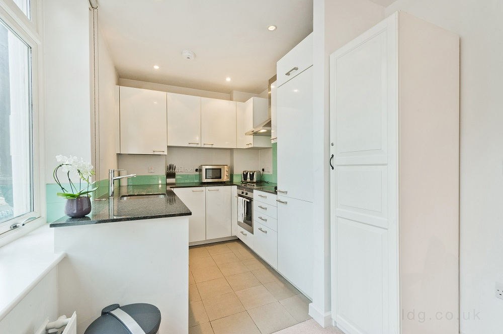 Kitchen at Alfred Place Apartments, Fitzrovia, London - Citybase Apartments