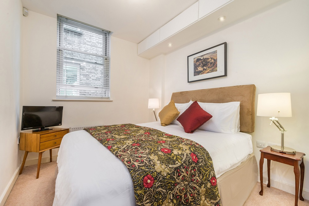 Bedroom TV at Alfred Place Apartments, Fitzrovia, London - Citybase Apartments