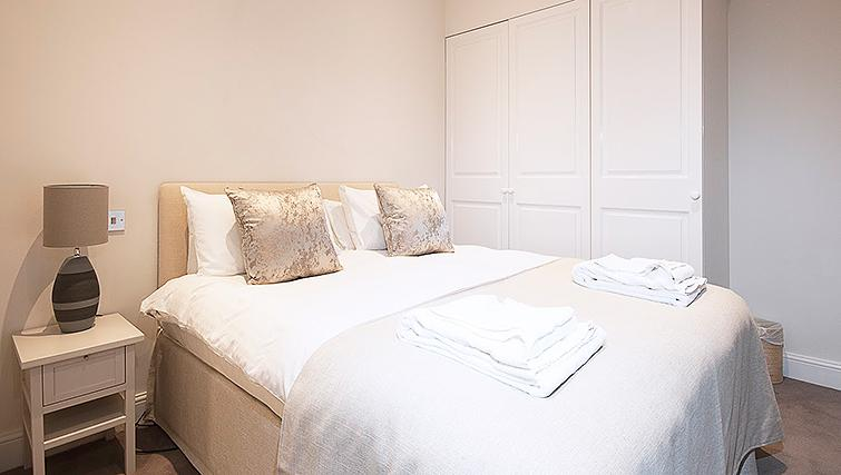 Beautiful bedroom at Manson Place Apartments - Citybase Apartments