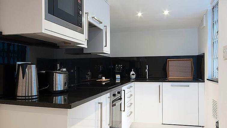 Fully equipped kitchen at Manson Place Apartments - Citybase Apartments