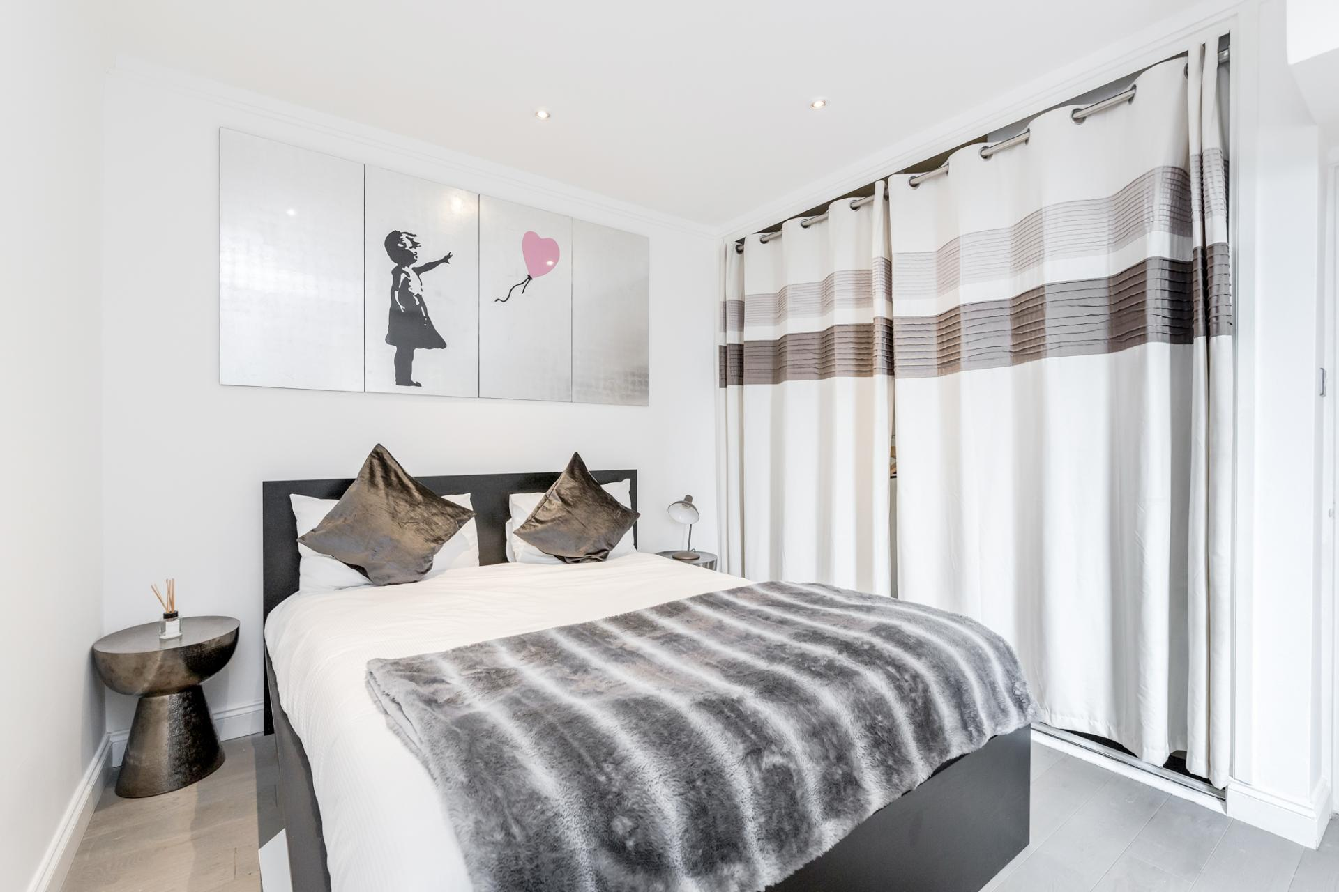 Bedroom at Earls Court Serviced Apartment, Kensington, London - Citybase Apartments