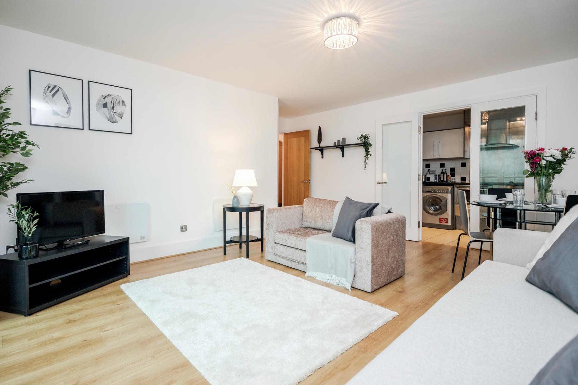 Living area at St Georges Wharf Apartment, Vauxhall, London - Citybase Apartments