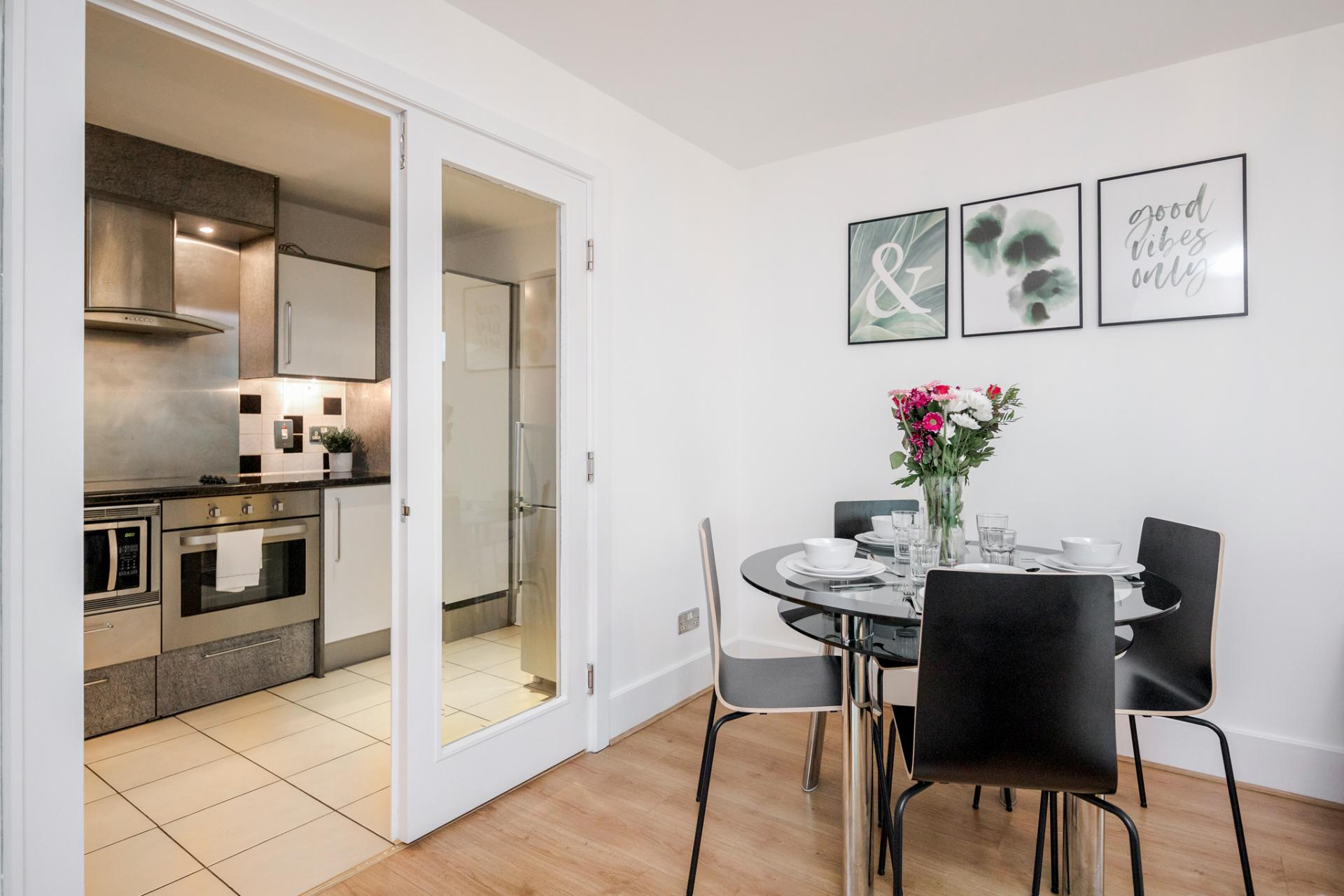 Dining area at St Georges Wharf Apartment, Vauxhall, London - Citybase Apartments
