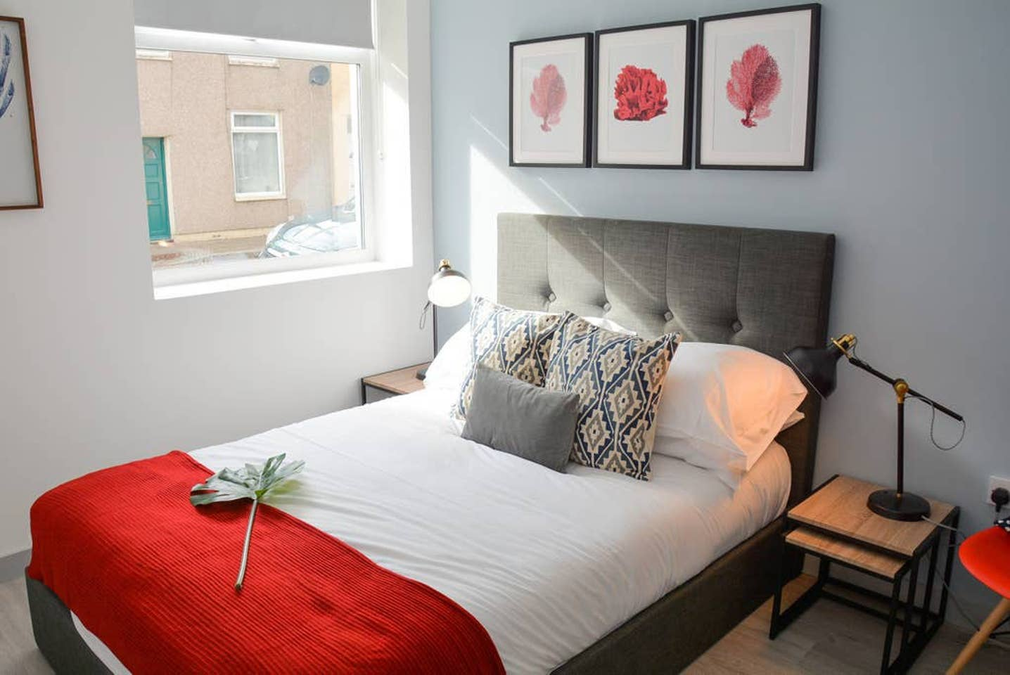 Red bedroom at Pearl House Serviced Apartments, Roath, Cardiff - Citybase Apartments