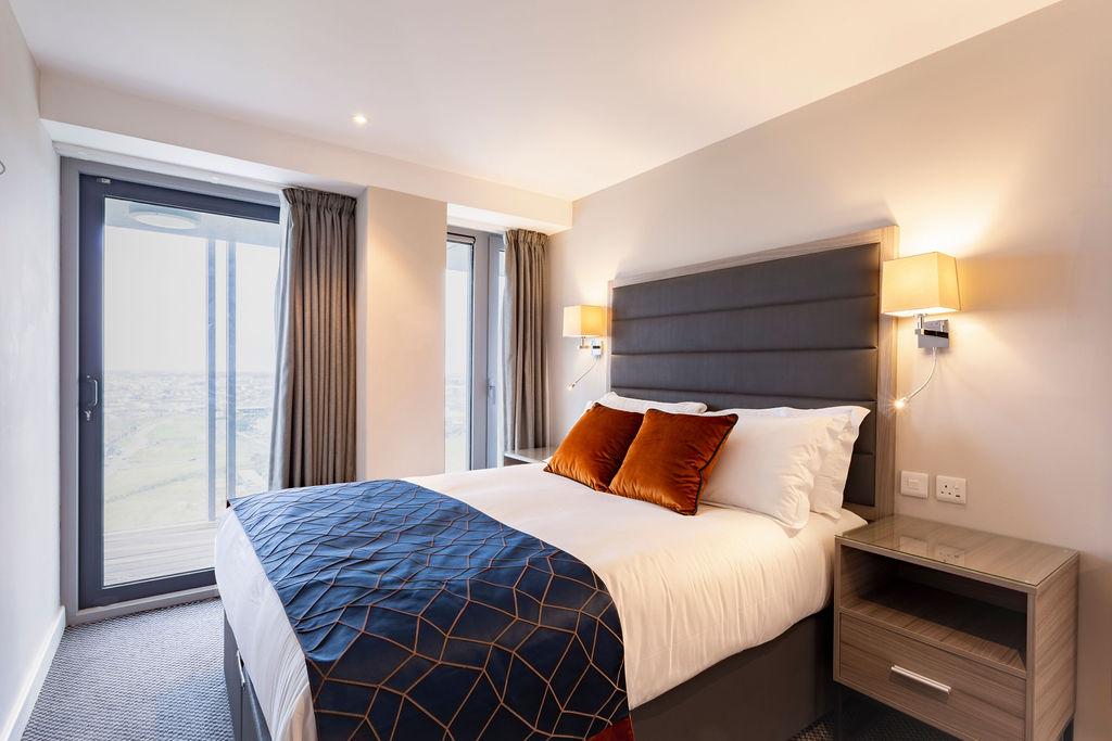 Bed at Metro Hotel Dublin Airport, Ballymun, Dublin - Citybase Apartments