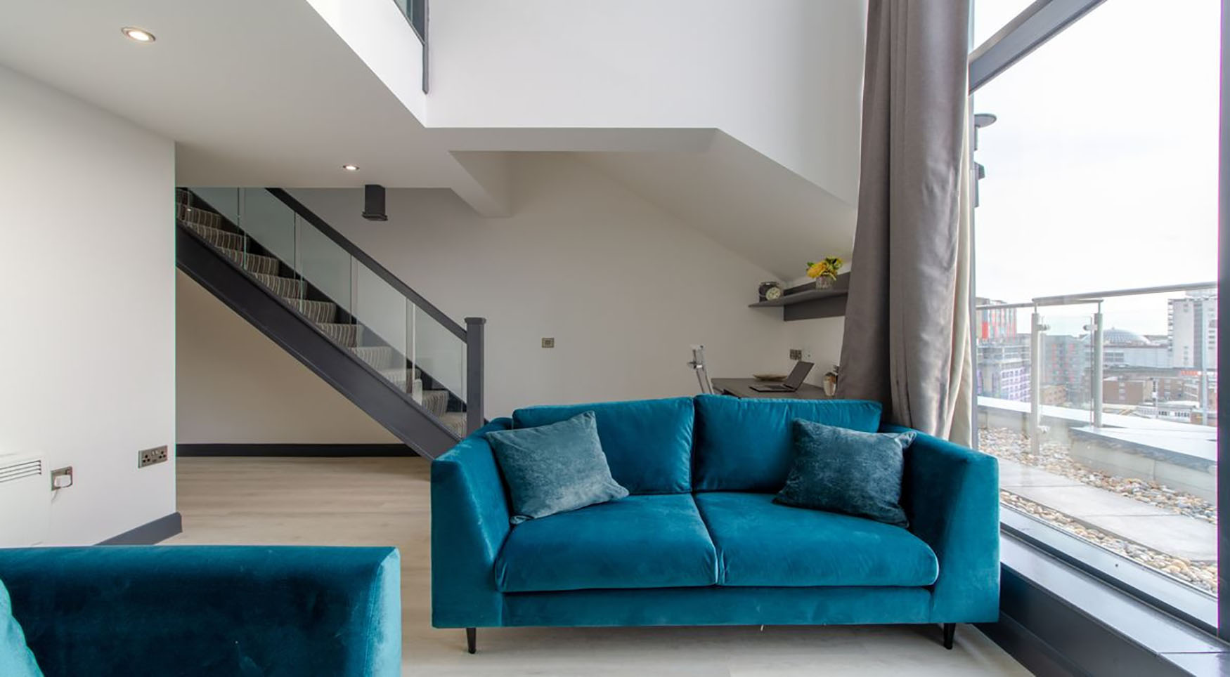 Blue sofa at The Residence Coventry, Centre, Newmarket - Citybase Apartments
