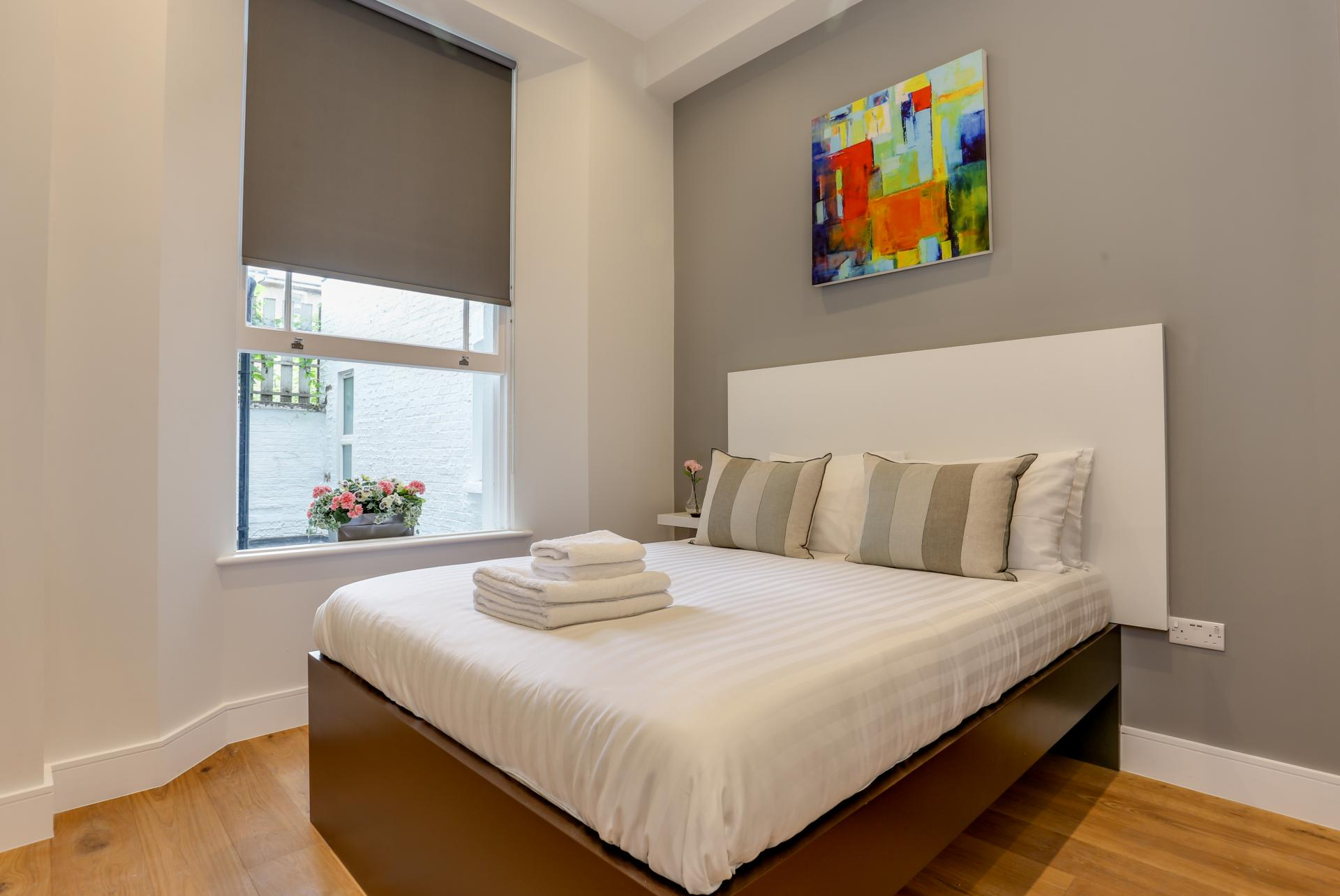 Bed at Queensborough Terrace, Bayswater, London - Citybase Apartments