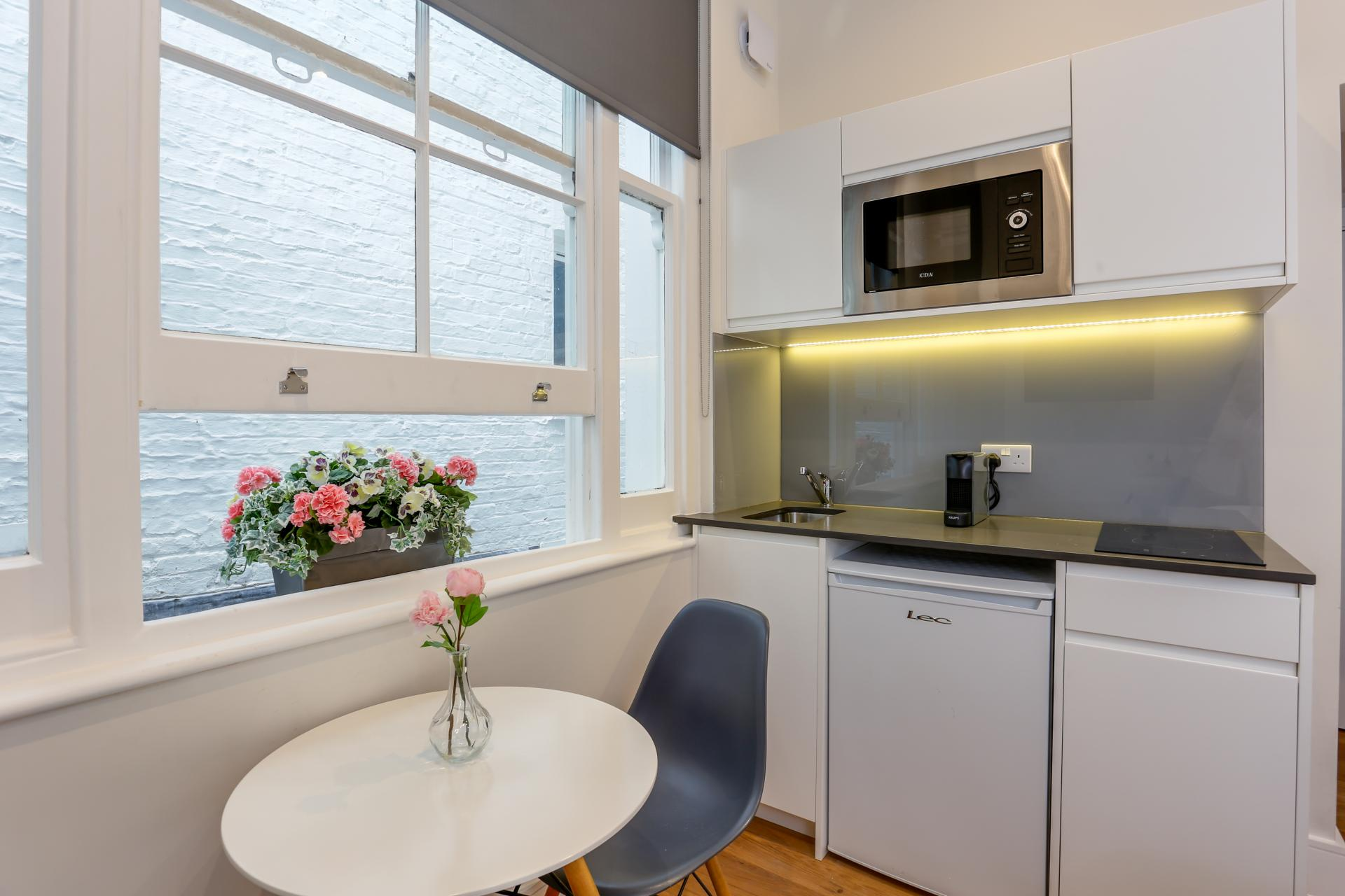 Microwave at Queensborough Terrace, Bayswater, London - Citybase Apartments