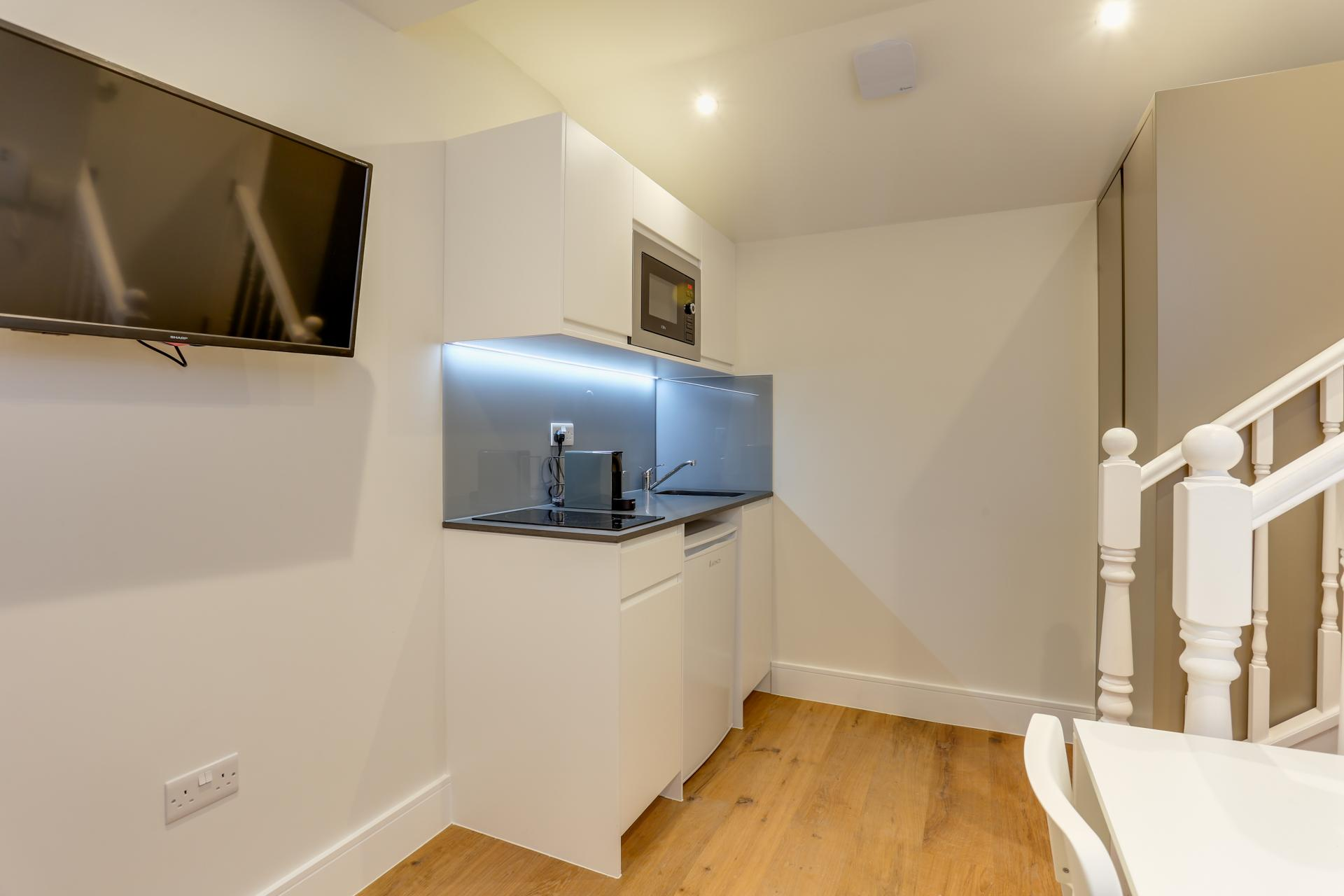 TV at Queensborough Terrace, Bayswater, London - Citybase Apartments