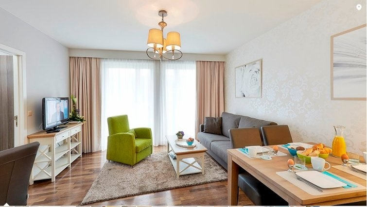 Stylish living area in Thon Residence Parnasse - Citybase Apartments
