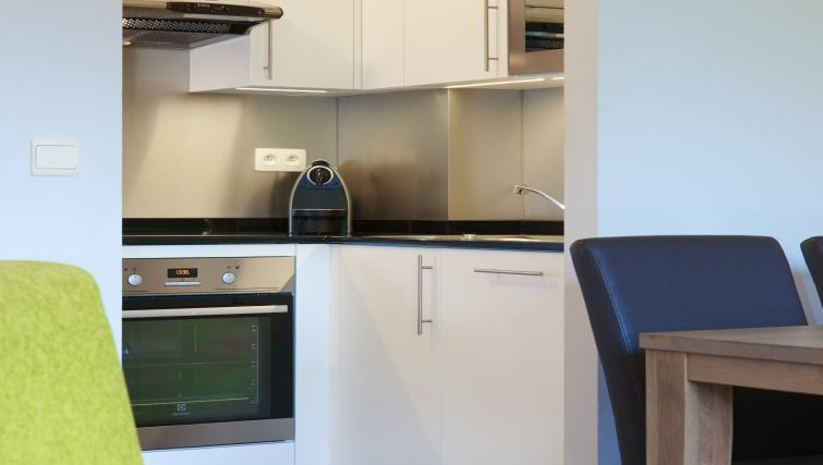 Equipped kitchen at Thon Residence Parnasse - Citybase Apartments