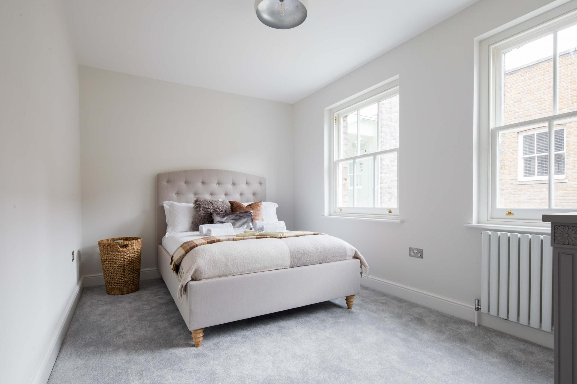 Bright bedroom at Rainsford Mews, Paddington, London - Citybase Apartments