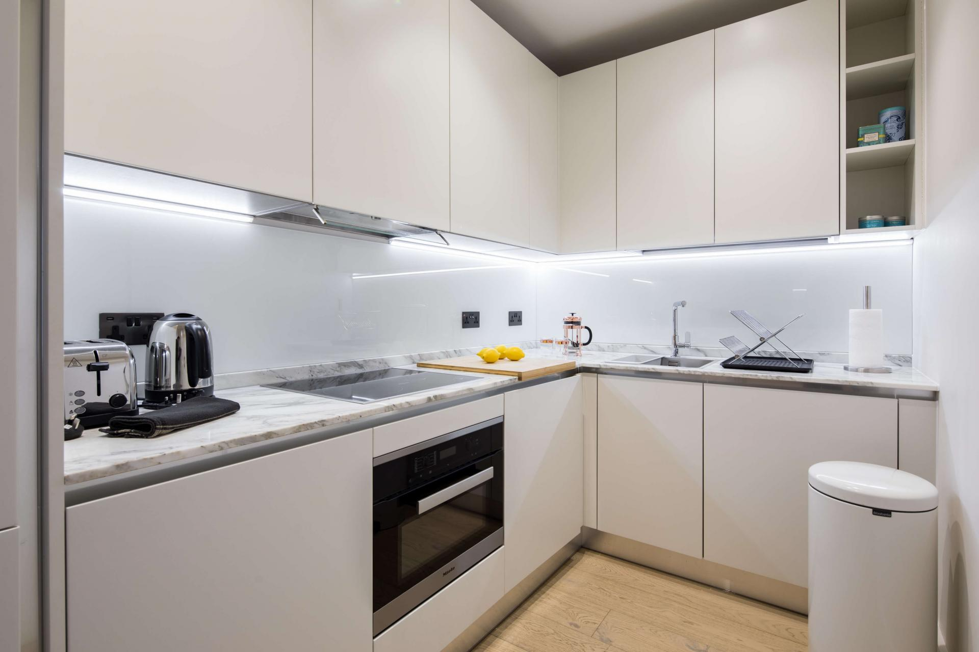 Sleek kitchen at Castle Lane Apartments, Westminster, London - Citybase Apartments