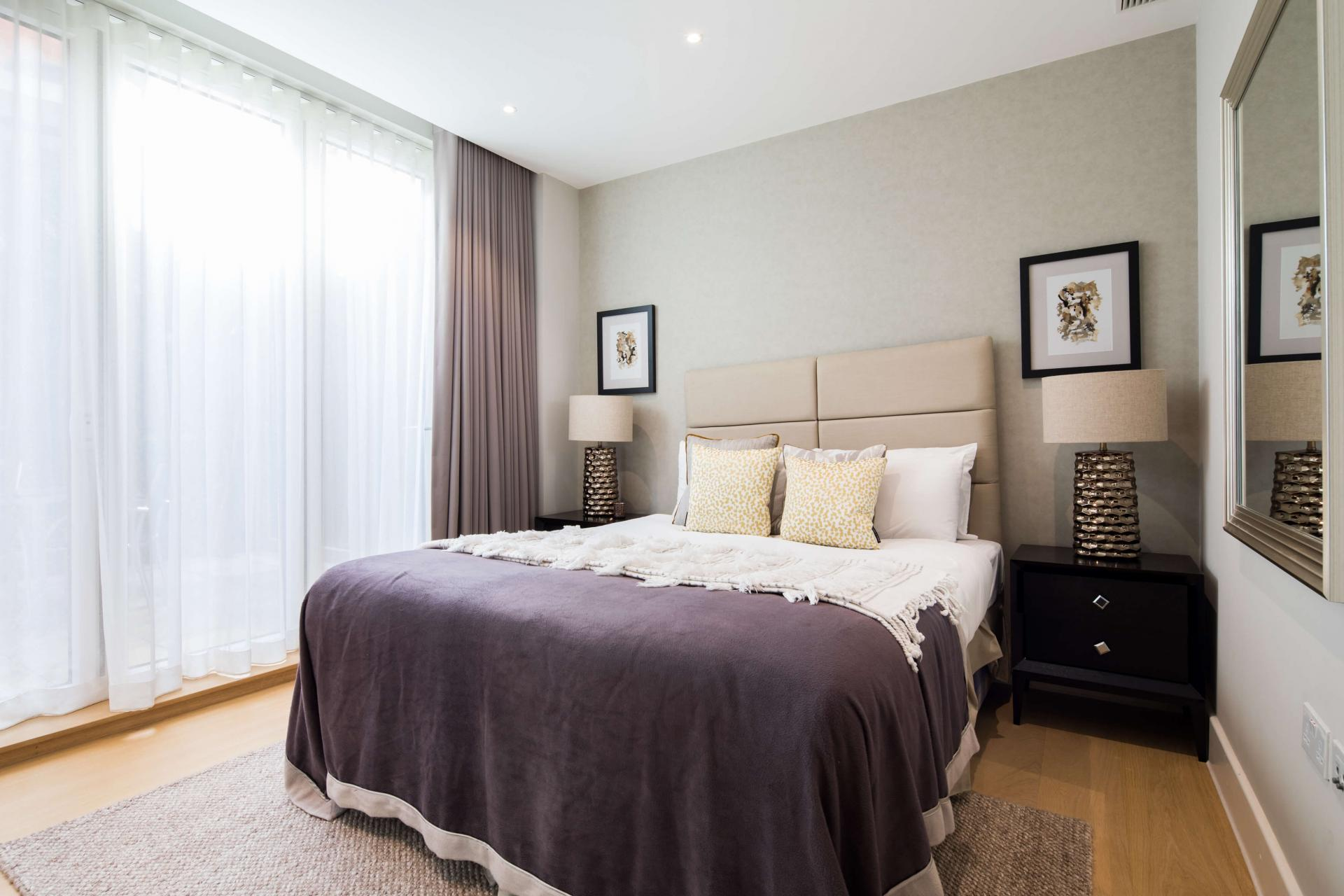 Grand bed at Logan Place Apartments, Kensington, London - Citybase Apartments