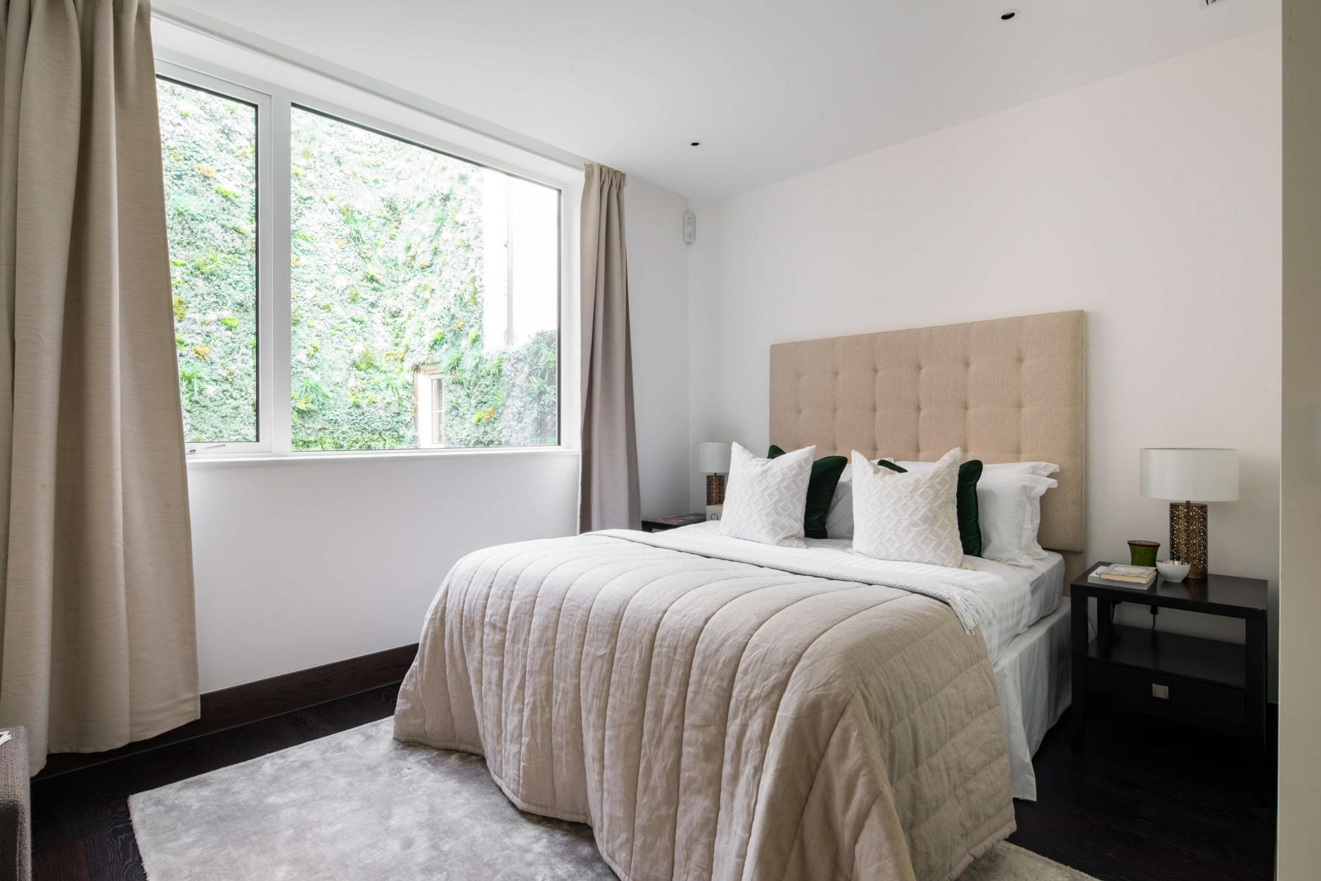 Bed at Logan Place Apartments, Kensington, London - Citybase Apartments