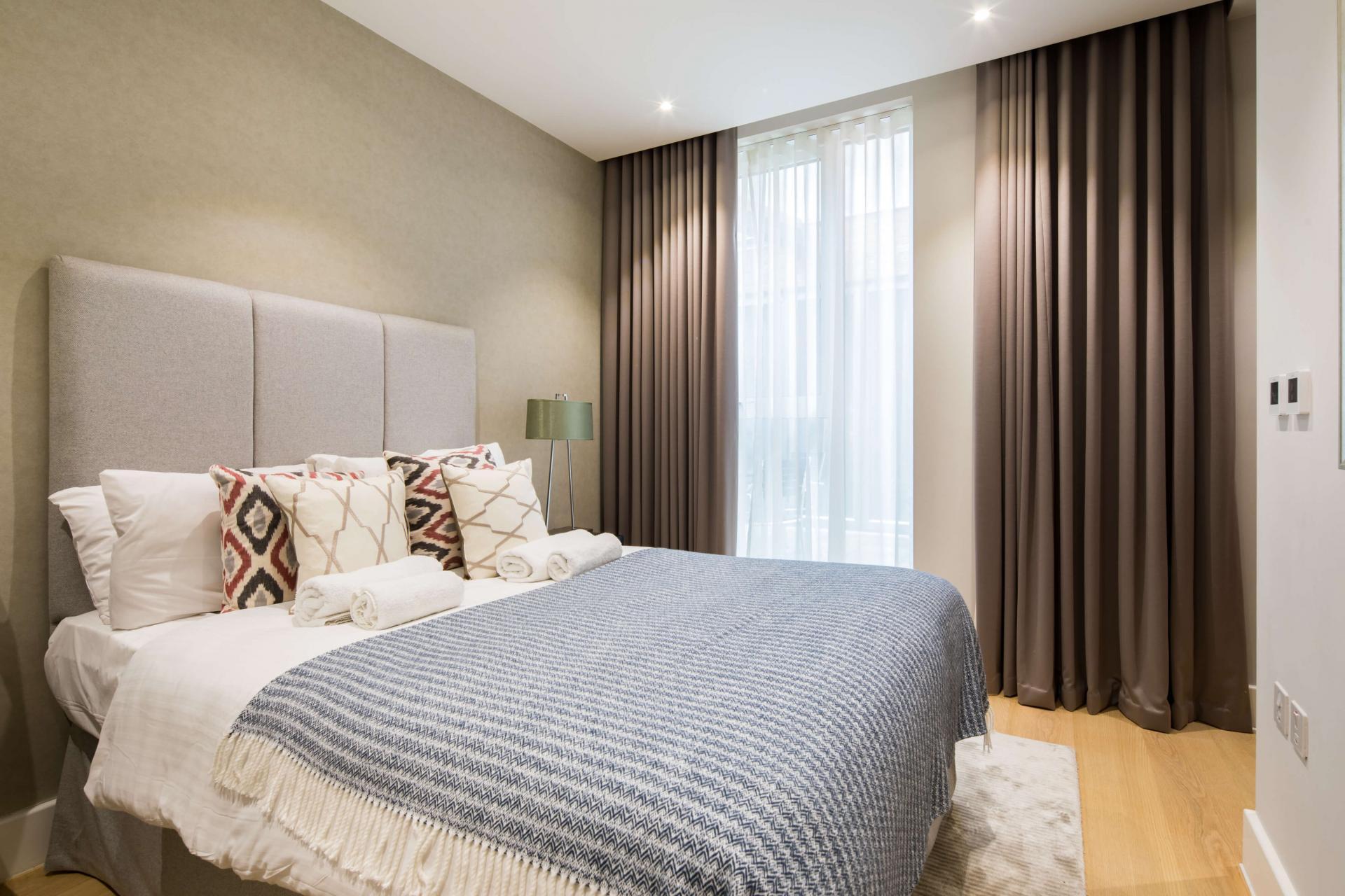 Bedroom at Logan Place Apartments, Kensington, London - Citybase Apartments
