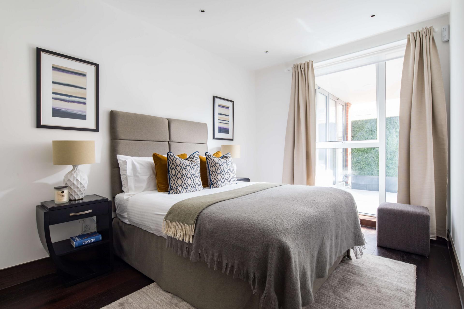 Comfy bed at Logan Place Apartments, Kensington, London - Citybase Apartments