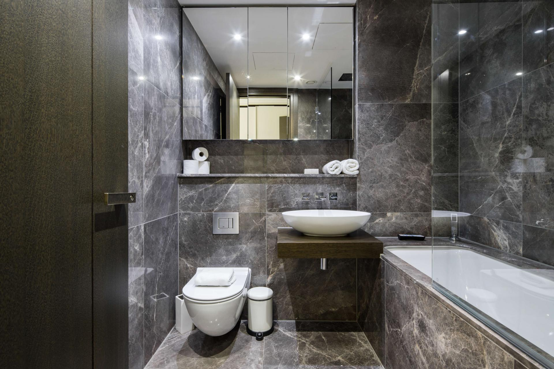 Modern bathroom at Logan Place Apartments, Kensington, London - Citybase Apartments