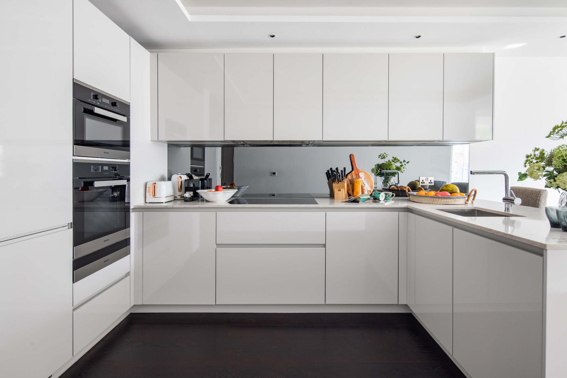 Sleek kitchen at Logan Place Apartments, Kensington, London - Citybase Apartments