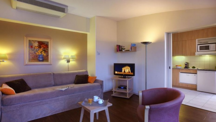 Vibrant living area in Citadines Didot Montparnasse Apartments - Citybase Apartments