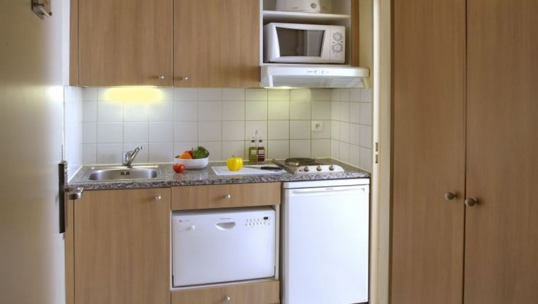 Compact kitchenette in Citadines Didot Montparnasse Apartments - Citybase Apartments