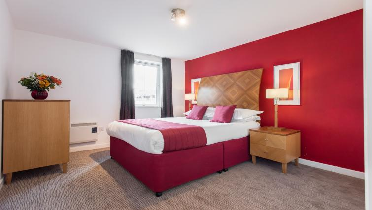 Double bed at Premier Suites Birmingham - Citybase Apartments