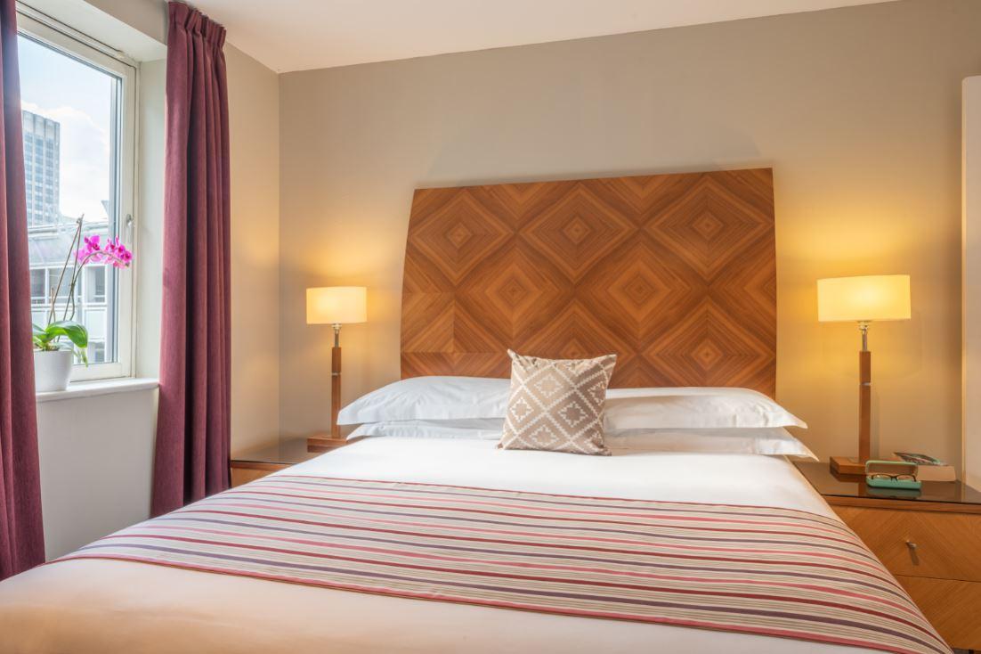 Bed at Premier Suites Birmingham - Citybase Apartments
