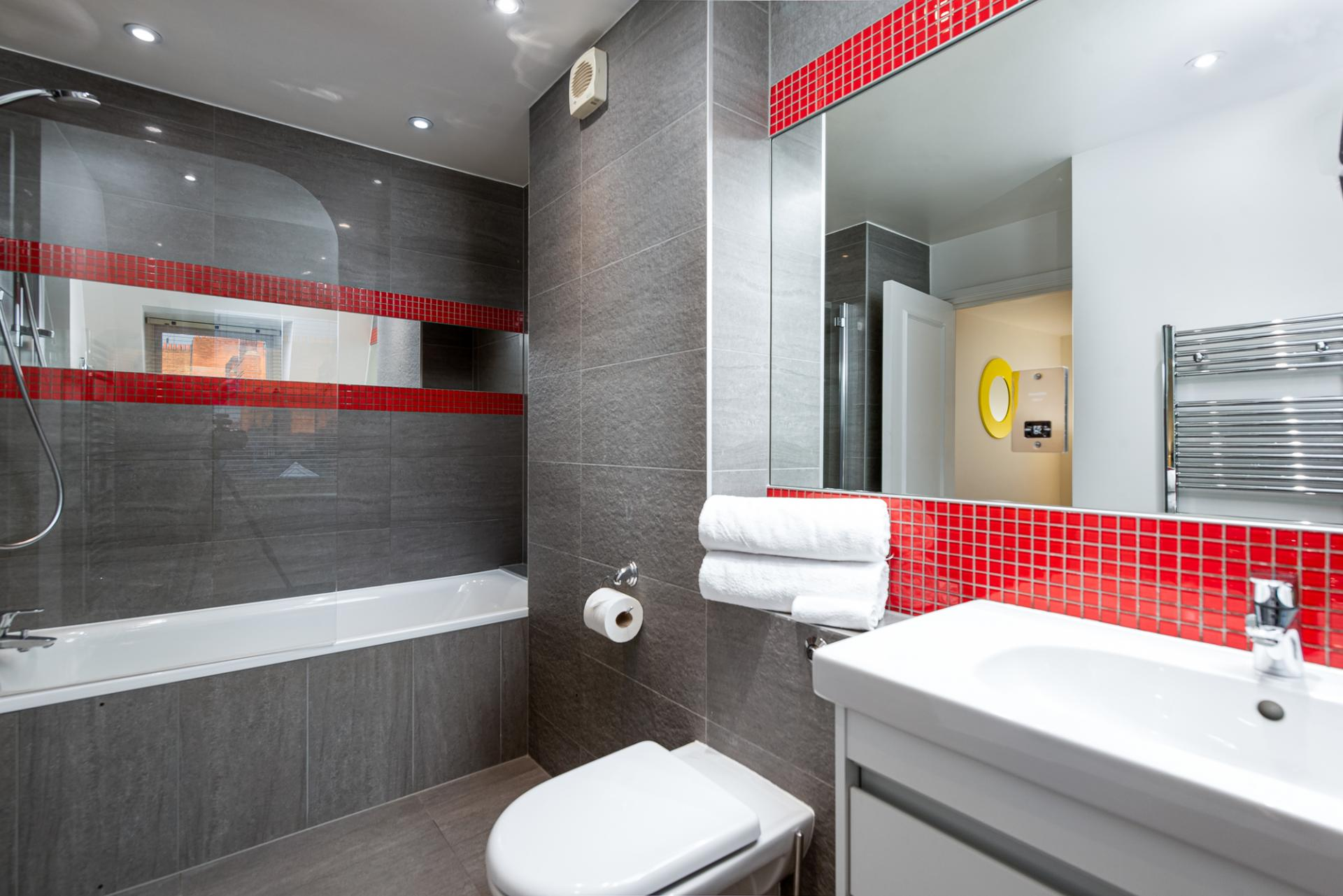 Sleek bathroom at Draycott Place Serviced Apartments, Chelsea, London - Citybase Apartments
