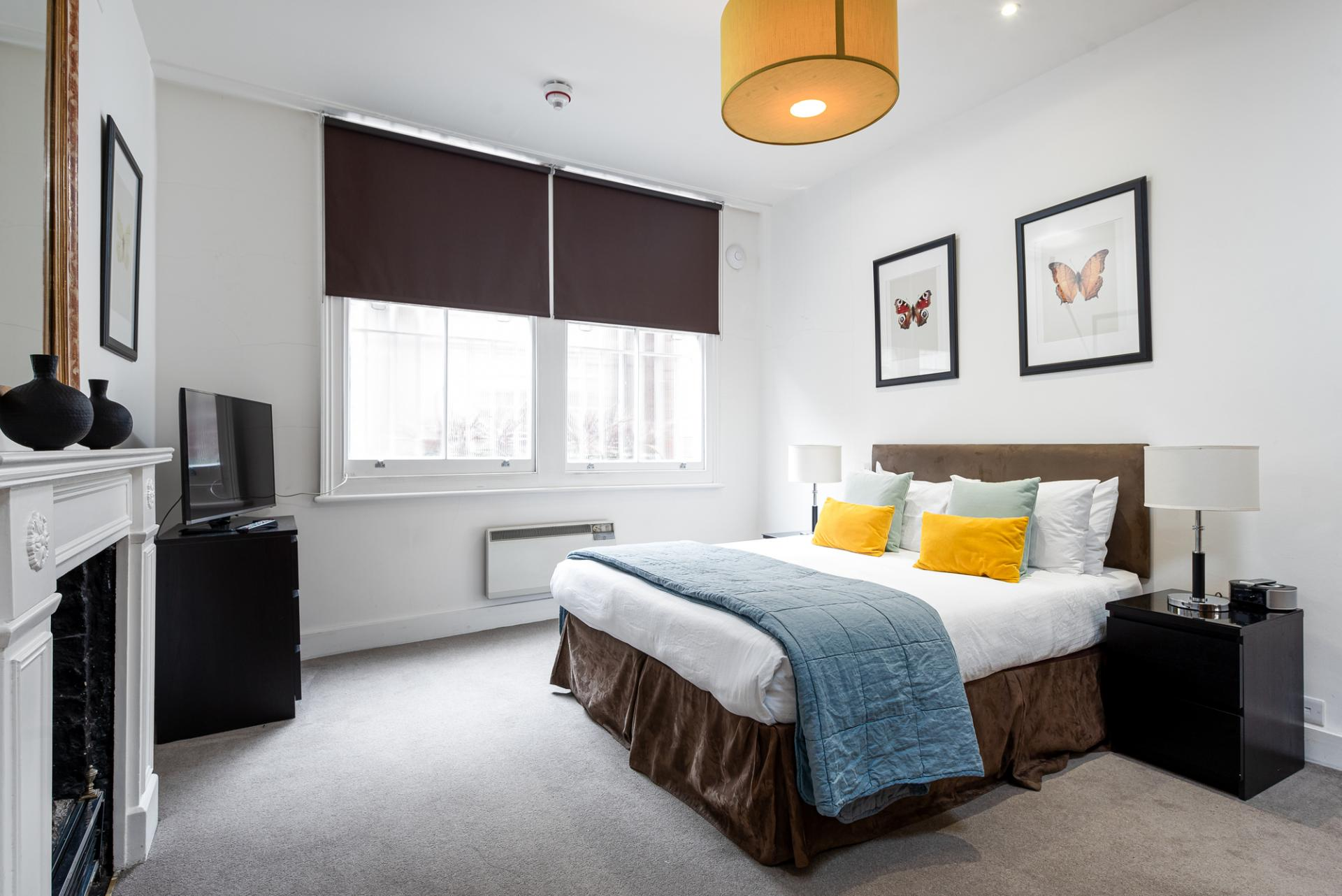Cosy bedroom at Draycott Place Serviced Apartments, Chelsea, London - Citybase Apartments