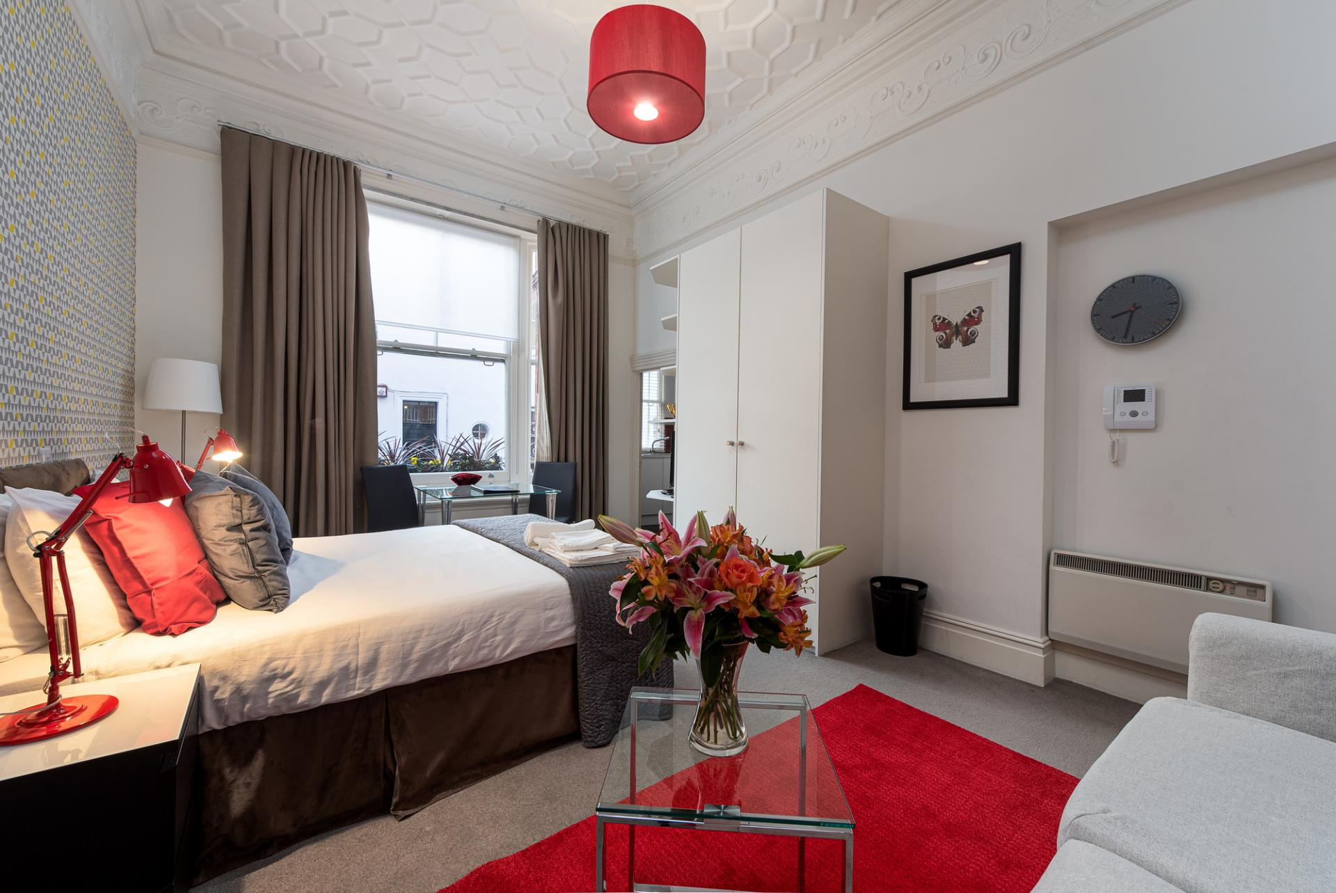 Red bedroom at Draycott Place Serviced Apartments, Chelsea, London - Citybase Apartments