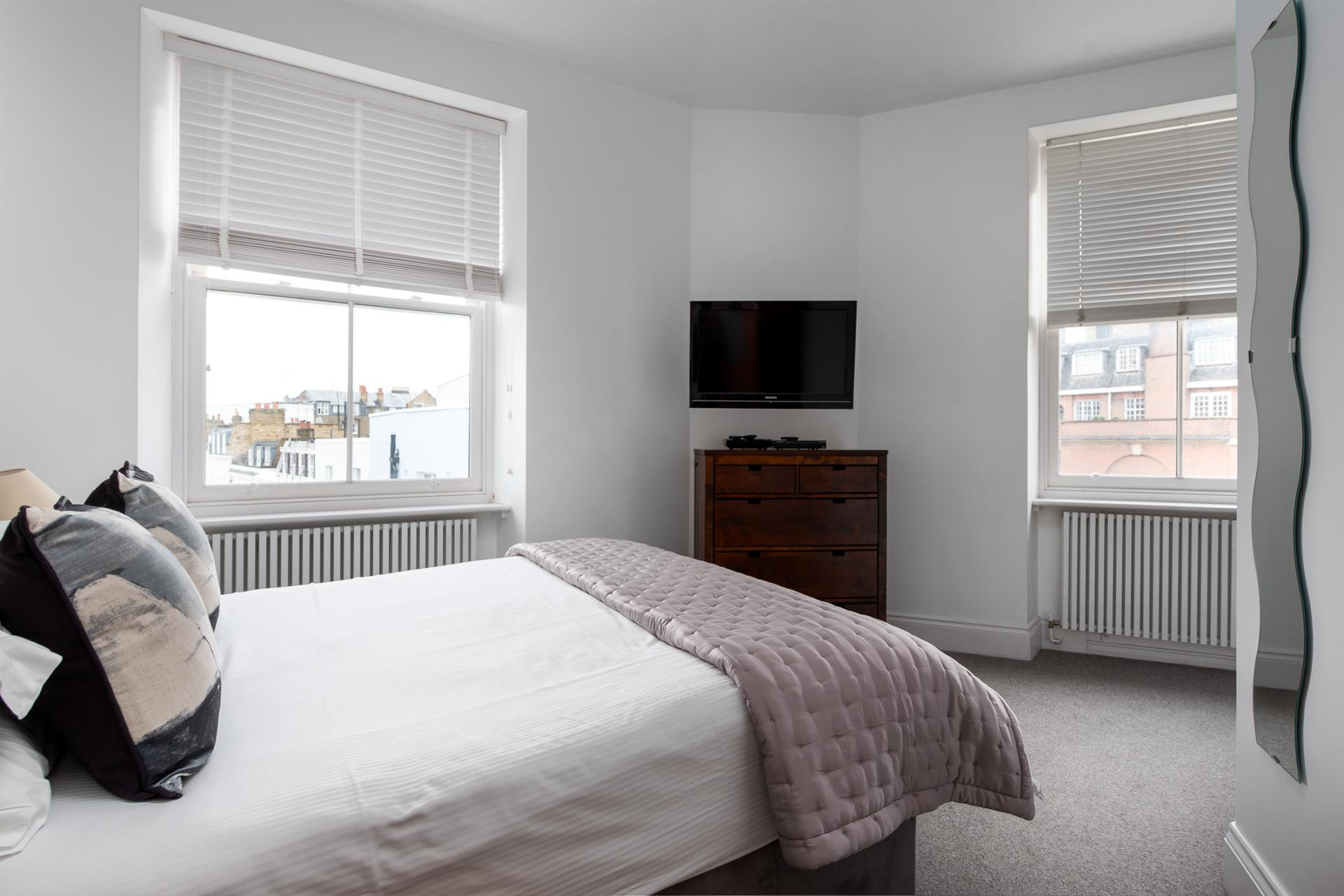 Bed at Chelsea Green Apartments, Chelsea, London - Citybase Apartments