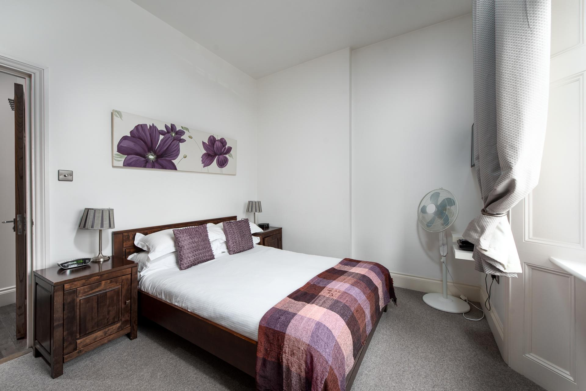 Bright bedroom at Chelsea Green Apartments, Chelsea, London - Citybase Apartments