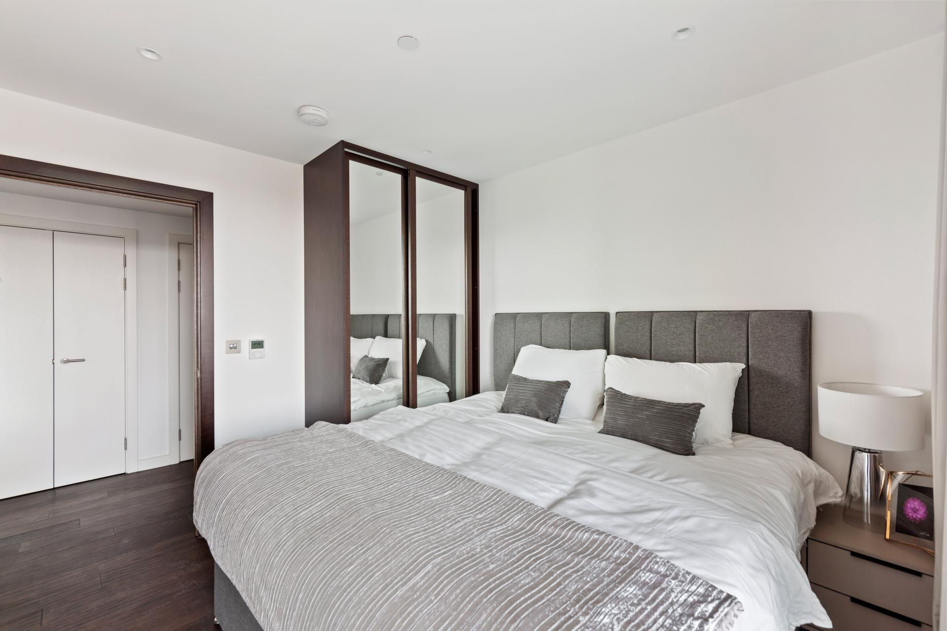 Bright bedroom at The Residence Tower Hill, Whitechapel, London - Citybase Apartments