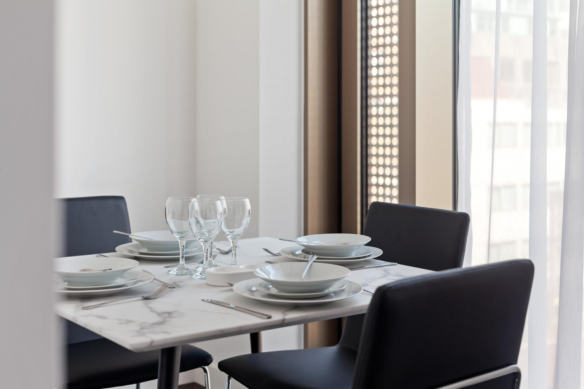 Dining area at The Residence Tower Hill, Whitechapel, London - Citybase Apartments