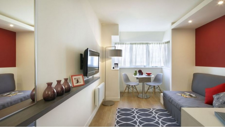 Compact living area in Citadines Maine Montparnasse Apartments - Citybase Apartments