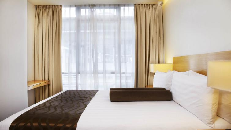 Practical bedroom at PARKROYAL Serviced Suites Kuala Lumpur - Citybase Apartments