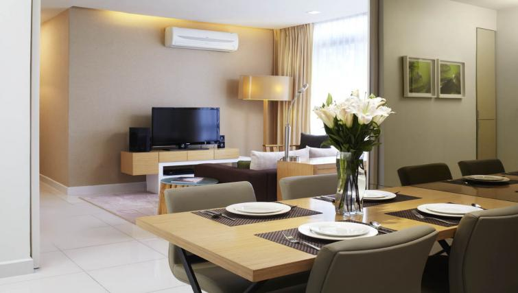 Furnished living area at PARKROYAL Serviced Suites Kuala Lumpur - Citybase Apartments