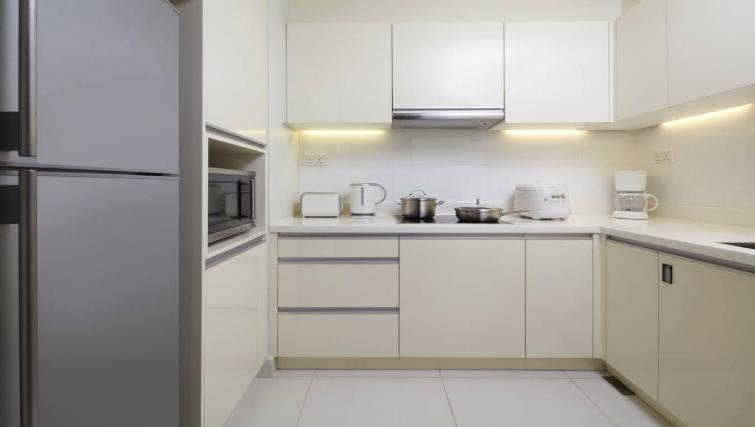 Equipped kitchen at PARKROYAL Serviced Suites Kuala Lumpur - Citybase Apartments