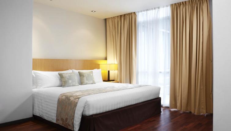 Spacious bedroom at PARKROYAL Serviced Suites Kuala Lumpur - Citybase Apartments