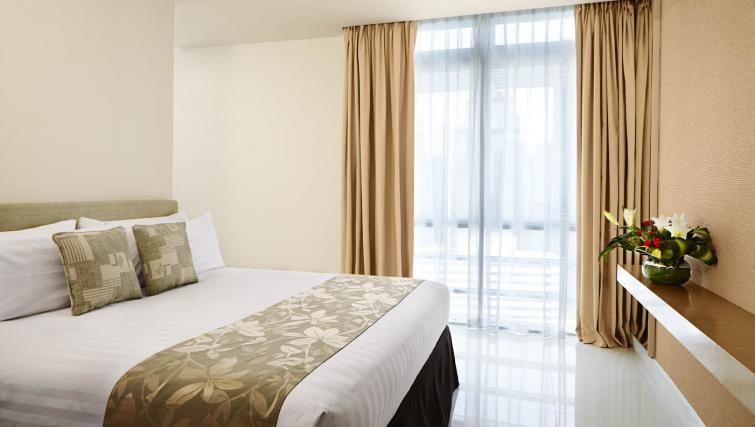 Comfy bedroom at PARKROYAL Serviced Suites Kuala Lumpur - Citybase Apartments