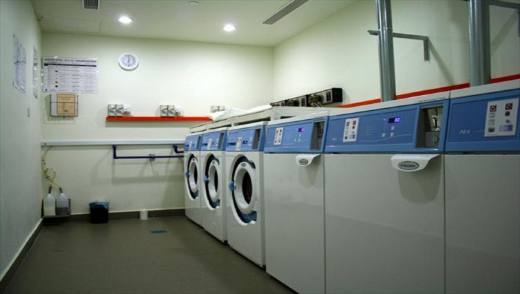 Communal laundry room at PARKROYAL Serviced Suites Kuala Lumpur - Citybase Apartments