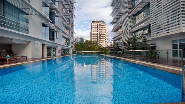 Outdoor swimming pool at PARKROYAL Serviced Suites Kuala Lumpur - Citybase Apartments