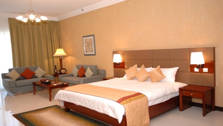 Charming bedroom in Metro Deira Apartments - Citybase Apartments