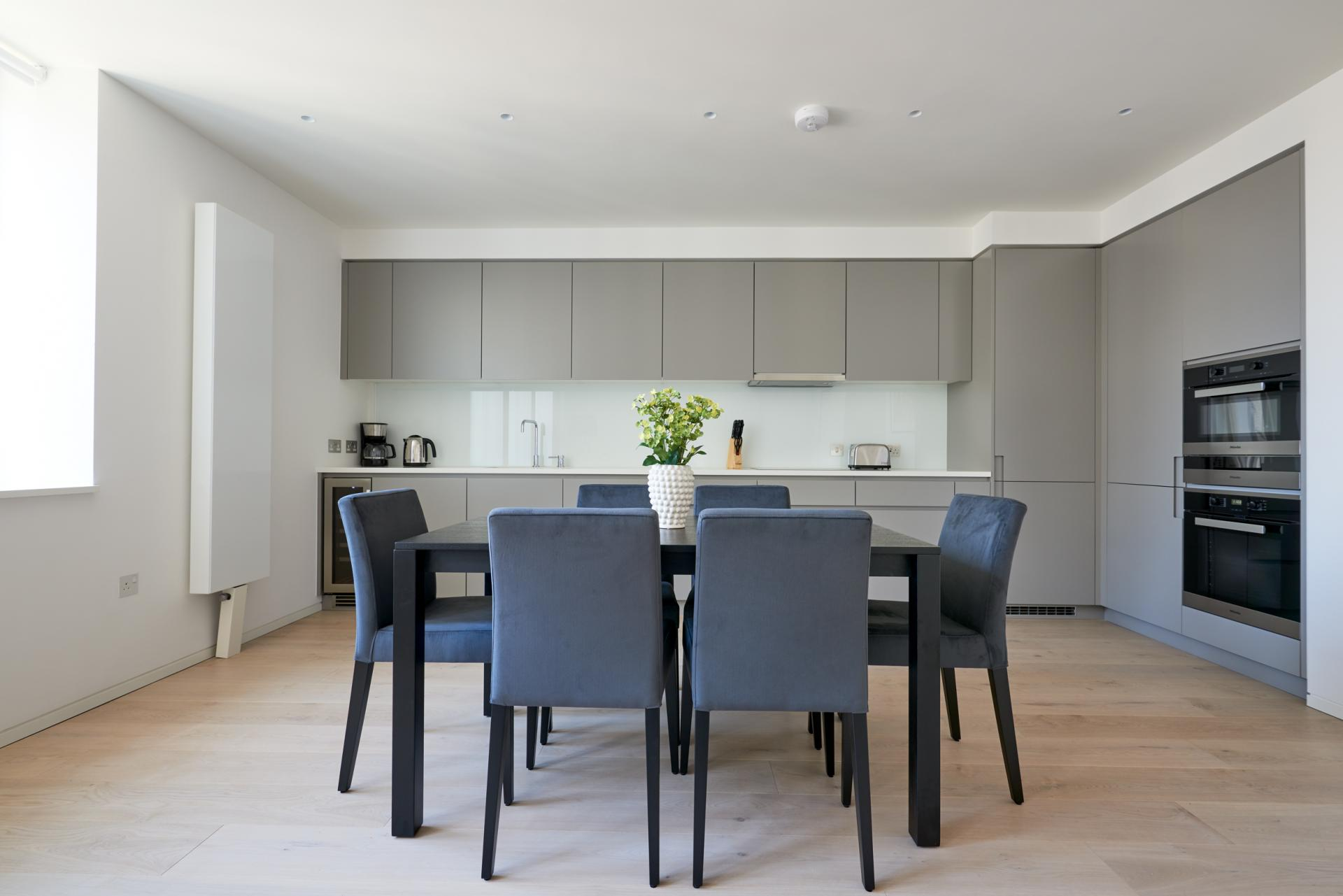 Kitchen diner at Great Portland Street Apartments, Fitzrovia, London - Citybase Apartments