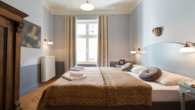 Bright bedroom at Antique Apartments - Citybase Apartments