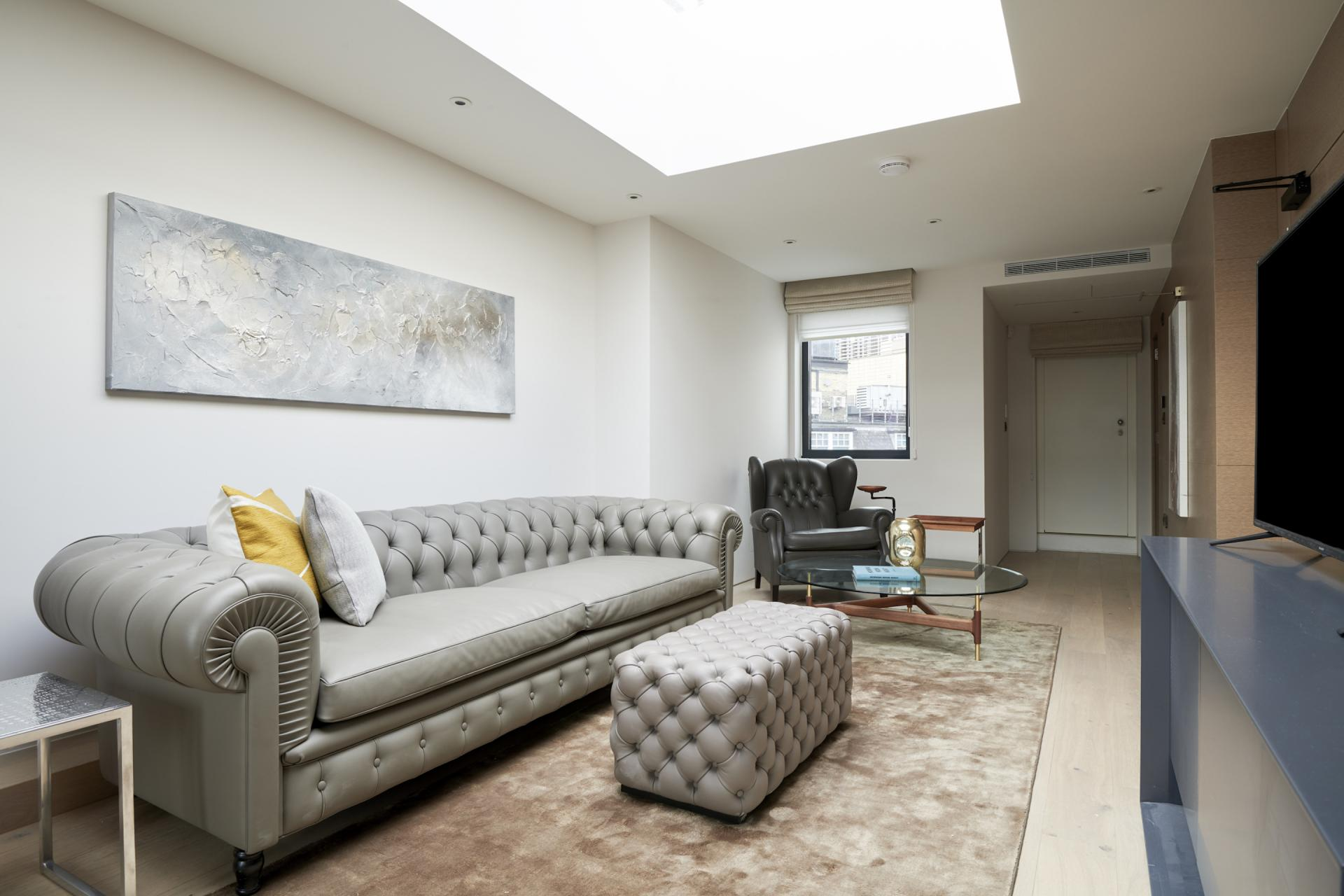 Living area at Maddox Suites, Carnaby, London - Citybase Apartments
