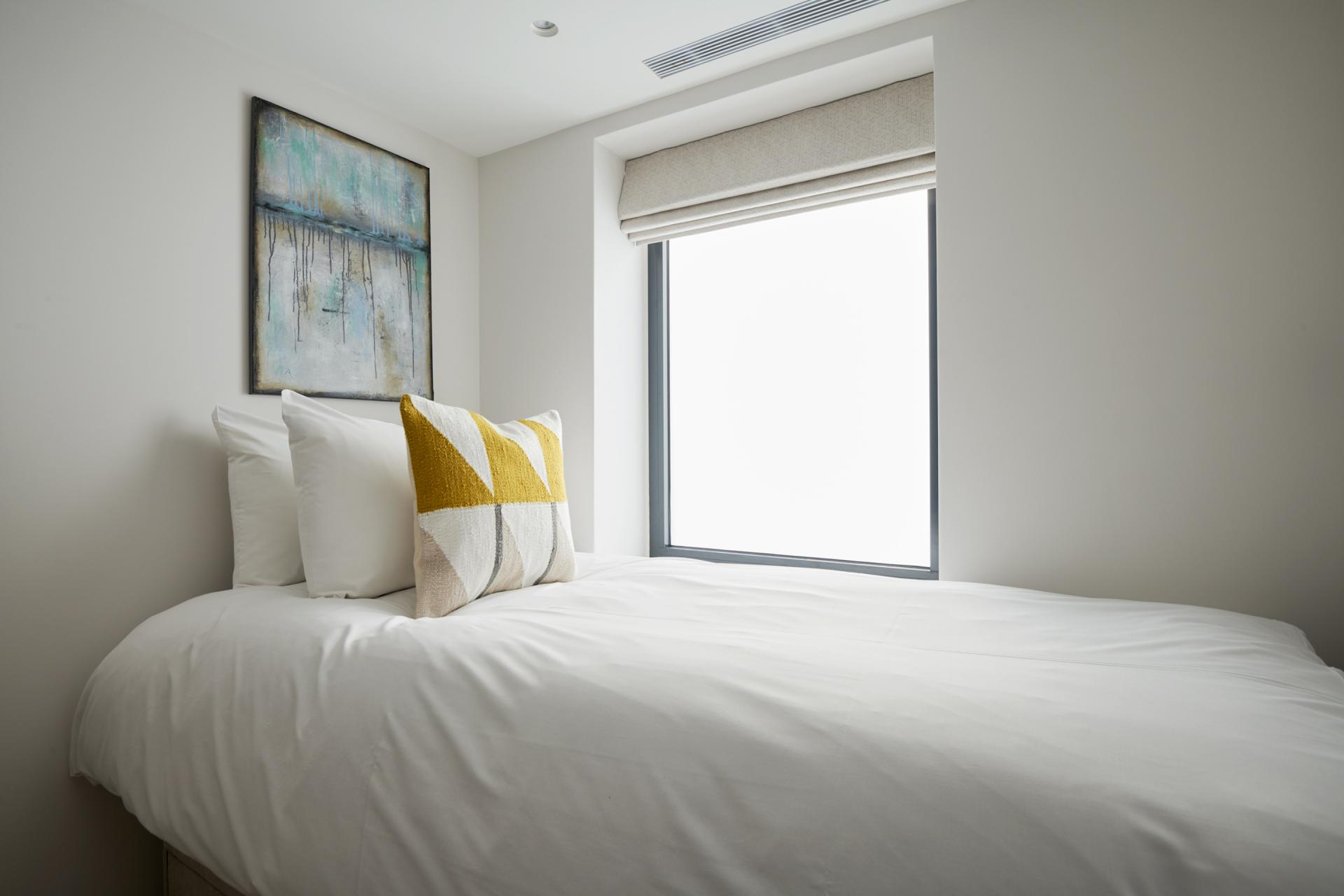 Single bed at Maddox Suites, Carnaby, London - Citybase Apartments
