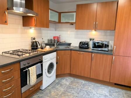 Kitchen at Clyde Waterfront Apartment - Citybase Apartments