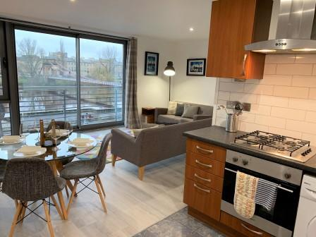 Spacious living area at Clyde Waterfront Apartment - Citybase Apartments