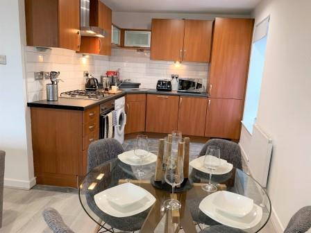 Dining table at Clyde Waterfront Apartment - Citybase Apartments